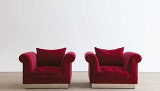 A standard Pair of deep buttoned armchairs