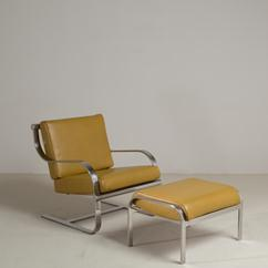 A Chromium Steel Cantilevered Armchair and Ottoman 1970s