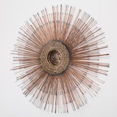 A Copper and Brass Toned Metal Starburst Wall Sculpture 1970s