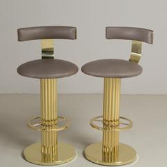 A Pair of Brass Framed Leather Upholstered Swivel Bar Stools 1980s