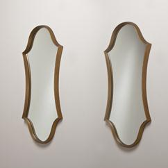 A Pair of Gold Hollywood Regency Keyhole Mirrors
