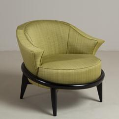 A Single Ebonised Framed Upholstered Armchair
