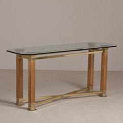 A Wood and Brass Console Table with a Glass Top