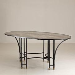 A Wrought Iron and Eglomise Top Oval Centre Table 1950s