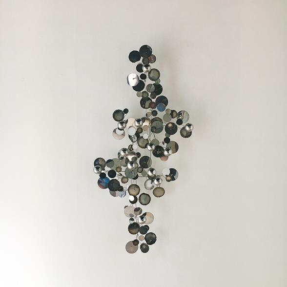 A Chrome Raindrops Wall Sculpture