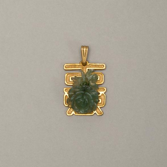 A Faux Jade Carved Rose and Gold Plated Pendant by Miriam Haskell