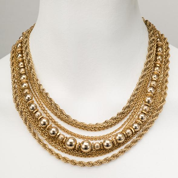 A Goldtone Multi Chain Necklace by Monet Stamped