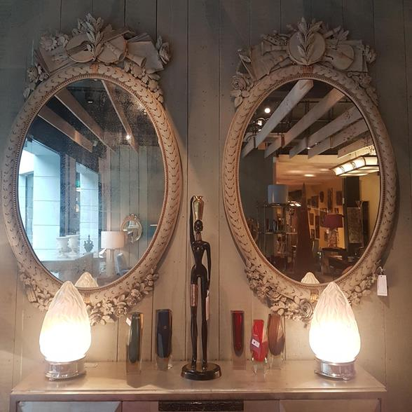 A Large pair of handed Napoleon III French Oval Mirrors