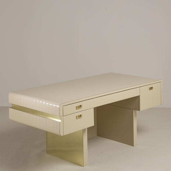 A Pace attributed Pedestal Based Brass and Ivory Mica Wrapped Desk 1970s