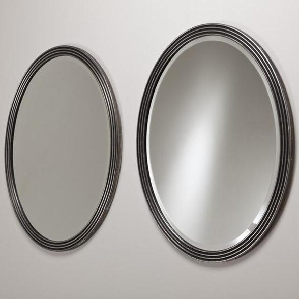A Pair of 1970s Oval Silver Gilt Mirrors