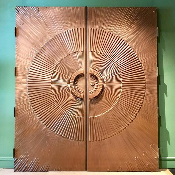 A Pair of Heroic Sunburst Doors by McCarroll and Gillespie